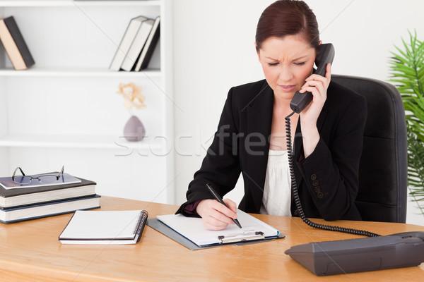 Aantrekkelijk vrouw pak schrijven notepad vergadering Stockfoto © wavebreak_media