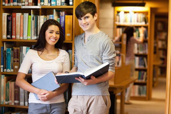Güzel Öğrenciler kitap kütüphane kitaplar öğrenci Stok fotoğraf © wavebreak_media