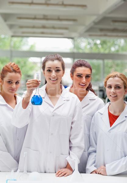 Portré labor partnerek pózol flaska mosolyog Stock fotó © wavebreak_media