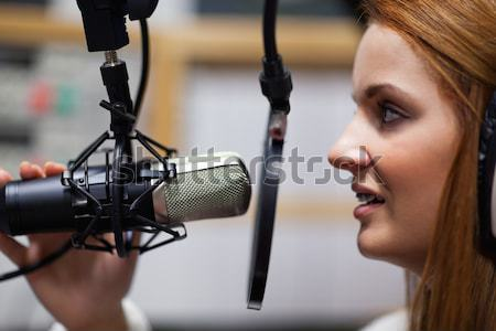 Close up of a cute singer recording a track in a studio Stock photo © wavebreak_media