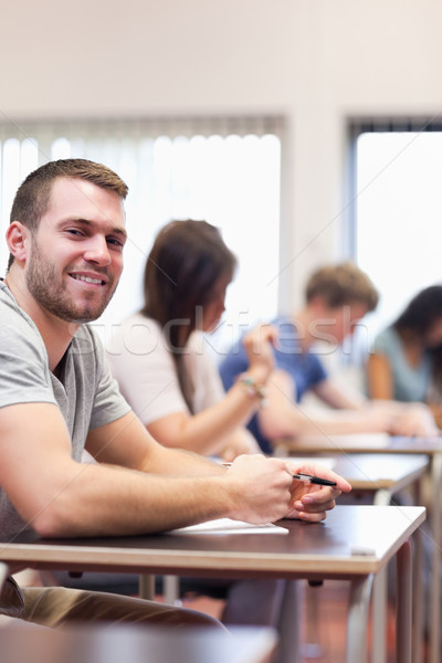 Portrait of a smiling young man in a classroom Stock photo © wavebreak_media