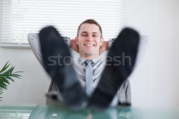 Young businessman sitting back behind a table Stock photo © wavebreak_media