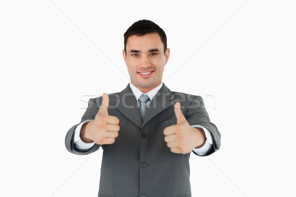 Businessman approving against a white background Stock photo © wavebreak_media