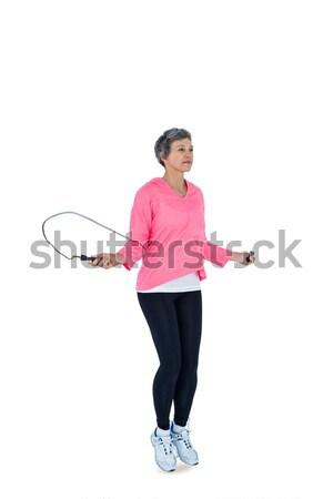 Ritratto montare donna manubri bianco Foto d'archivio © wavebreak_media