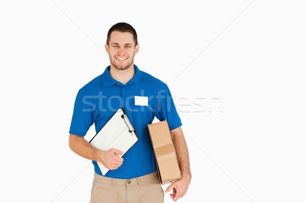 Lächelnd jungen Verkäufer Paket Zwischenablage weiß Stock foto © wavebreak_media