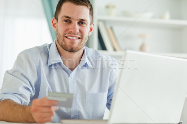 Young businessman with notebook and credit card Stock photo © wavebreak_media