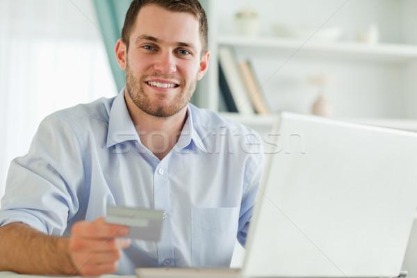 Genç işadamı defter kredi kartı bilgisayar Internet Stok fotoğraf © wavebreak_media
