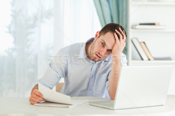 Stock photo: Young businessman received an alarming letter