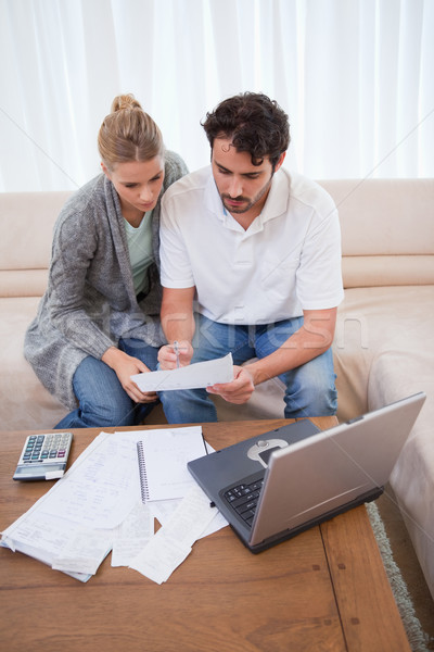 Portrait of a couple doing their accounting with a laptop in their living room Stock photo © wavebreak_media