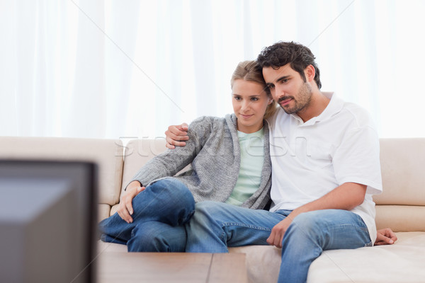Young couple watching TV in their living room Stock photo © wavebreak_media