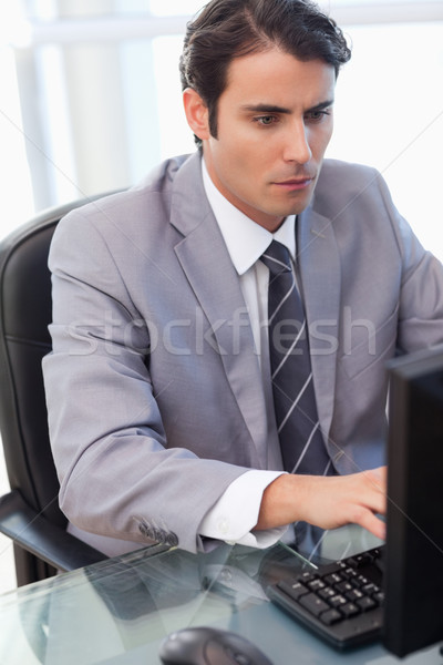 Portrait of a focused businessman working with a computer in his office Stock photo © wavebreak_media