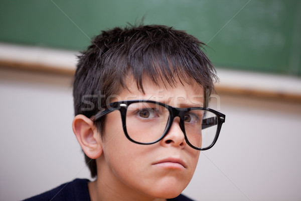 Sério estudante sala de aula cara criança Foto stock © wavebreak_media