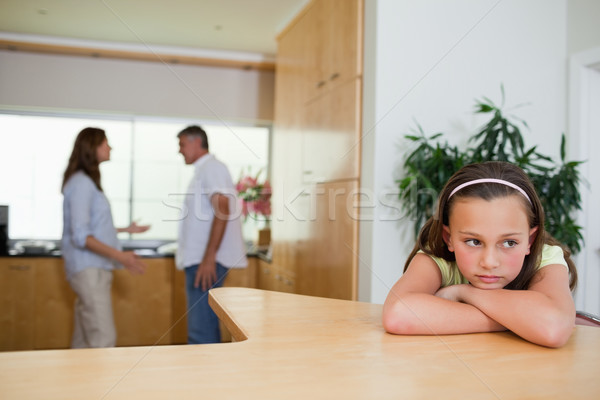 Stock photo: Sad girl listening to her fighting parents