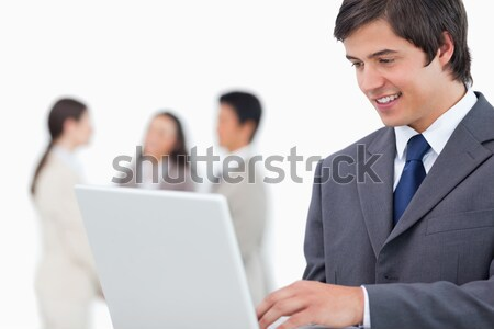 Verkoper laptop collega's achter witte business Stockfoto © wavebreak_media