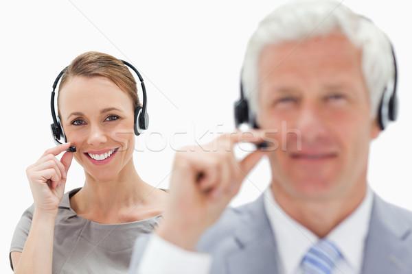 Uśmiechnięta kobieta mówić siwe włosy człowiek Zdjęcia stock © wavebreak_media