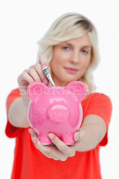 Piggy bank mulher notas branco mãos sorrir Foto stock © wavebreak_media