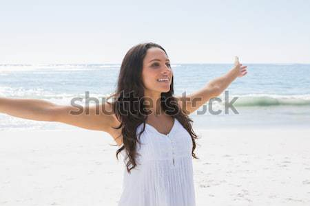 Young woman standing upright with her hand on her head in front of the sea Stock photo © wavebreak_media