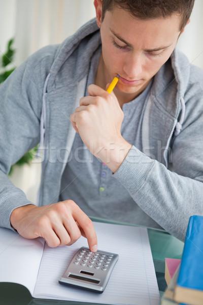 Diák számológép házi feladat könyvek otthon szoba Stock fotó © wavebreak_media
