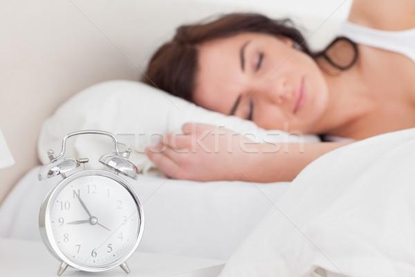 Bruna donna dormire mattina camera da letto tempo Foto d'archivio © wavebreak_media