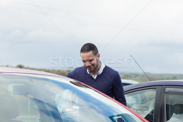 Buyer looking inside a car on a parking Stock photo © wavebreak_media