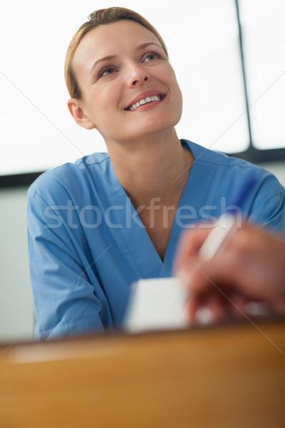 Enfermeira olhando alguém assinatura papel hospital Foto stock © wavebreak_media