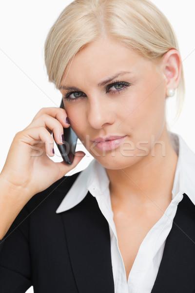 Belle femme d'affaires mobiles blanche téléphone costume Photo stock © wavebreak_media