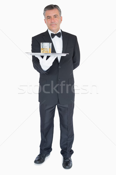 Man in suit holding silver tray with glasses of whiskey Stock photo © wavebreak_media