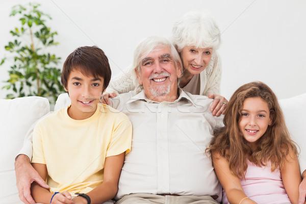 Grands-parents petits enfants canapé souriant maison amour Photo stock © wavebreak_media