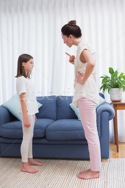 Mother scolding her naughty daughter Stock photo © wavebreak_media