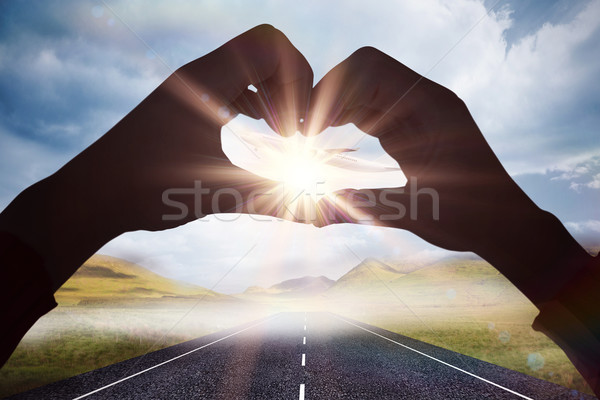 Composite image of woman making heart shape with hands Stock photo © wavebreak_media