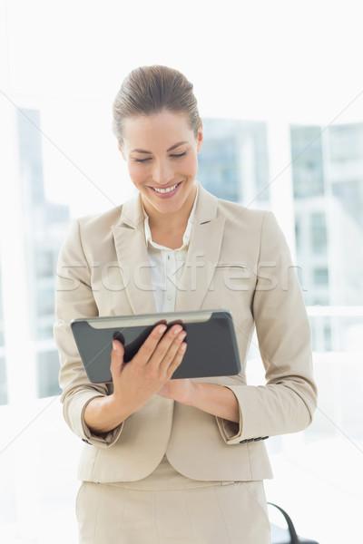 Beautiful businesswoman using digital tablet Stock photo © wavebreak_media