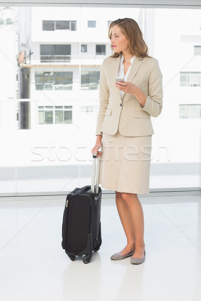 Businesswoman text messaging while on business trip Stock photo © wavebreak_media