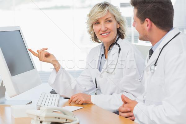 Doctors using computer at medical office Stock photo © wavebreak_media