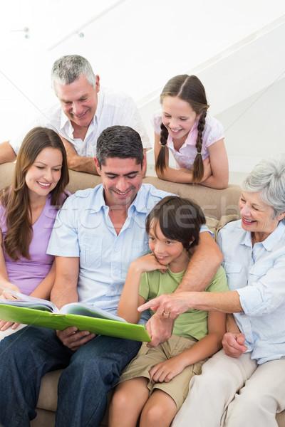 Stock fotó: Boldog · család · olvas · könyv · boldog · család · otthon