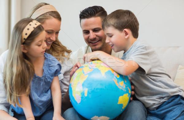 Family searching places on globe Stock photo © wavebreak_media