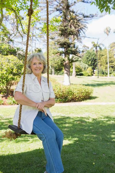 улыбаясь сидят Swing парка портрет Сток-фото © wavebreak_media