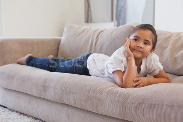 Nyugodt fiatal lány kanapé nappali otthon gyermek Stock fotó © wavebreak_media