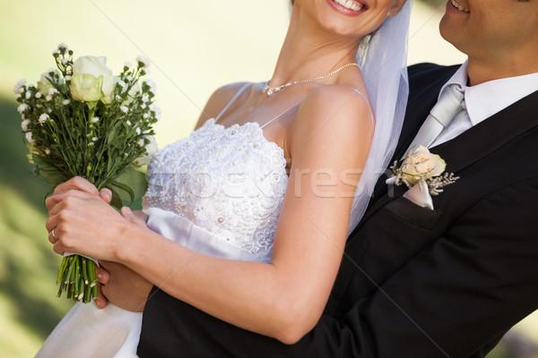 Feliz recém-casado casal parque vista lateral Foto stock © wavebreak_media