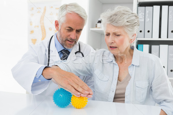Doctor with senior patient using stress buster balls Stock photo © wavebreak_media