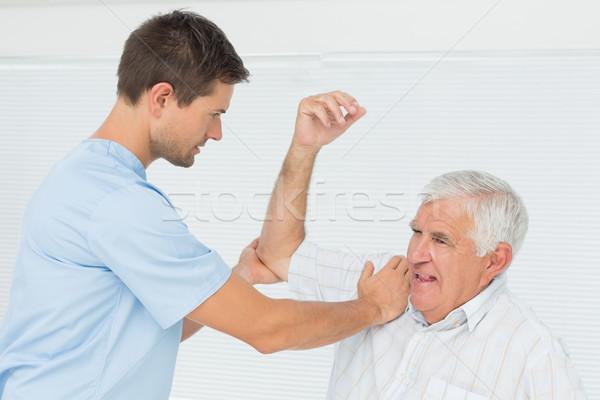 Senior homem mão masculino médico escritório Foto stock © wavebreak_media