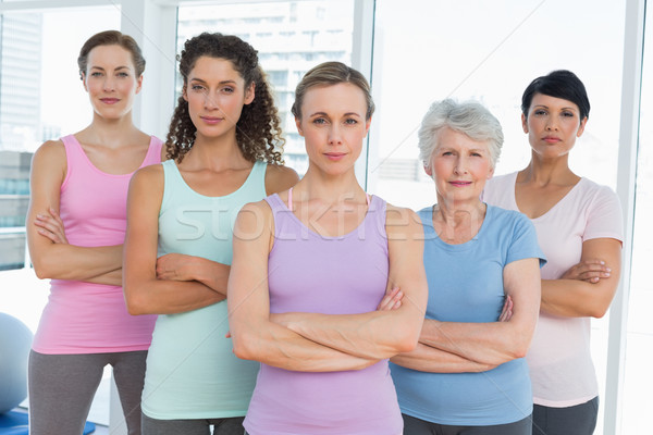 Confident women with arms crossed in yoga class Stock photo © wavebreak_media
