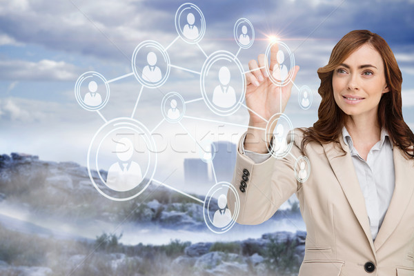Smiling businesswoman pointing to profile picture Stock photo © wavebreak_media