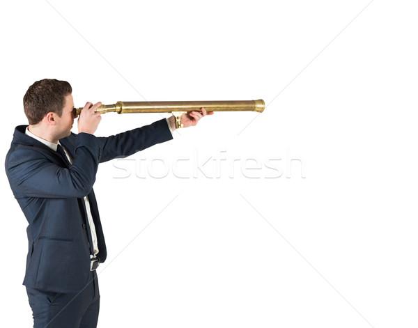 Biznesmen stałego patrząc teleskop biały korporacyjnych Zdjęcia stock © wavebreak_media