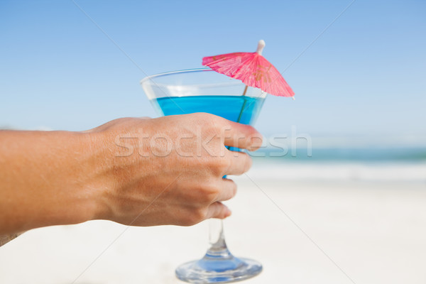 Woman sitting in deck chair with a cocktail at the beach Stock photo © wavebreak_media