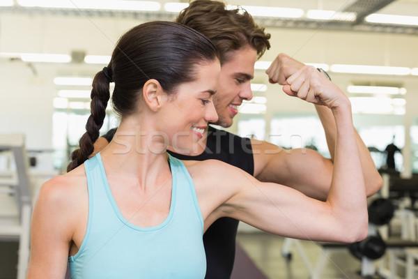 Fit attractive couple comparing biceps Stock photo © wavebreak_media
