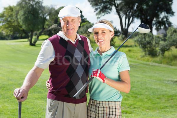Golf çift gülen kamera golf sahası Stok fotoğraf © wavebreak_media