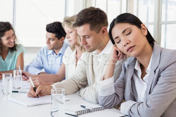 Casual businesswoman falling asleep during meeting Stock photo © wavebreak_media