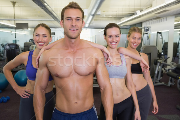 Smiling fitness class posing together Stock photo © wavebreak_media