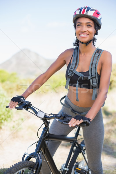 Fit woman going for bike ride Stock photo © wavebreak_media