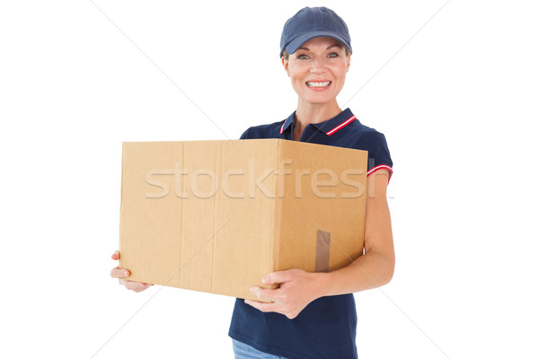 Happy delivery woman holding cardboard box Stock photo © wavebreak_media